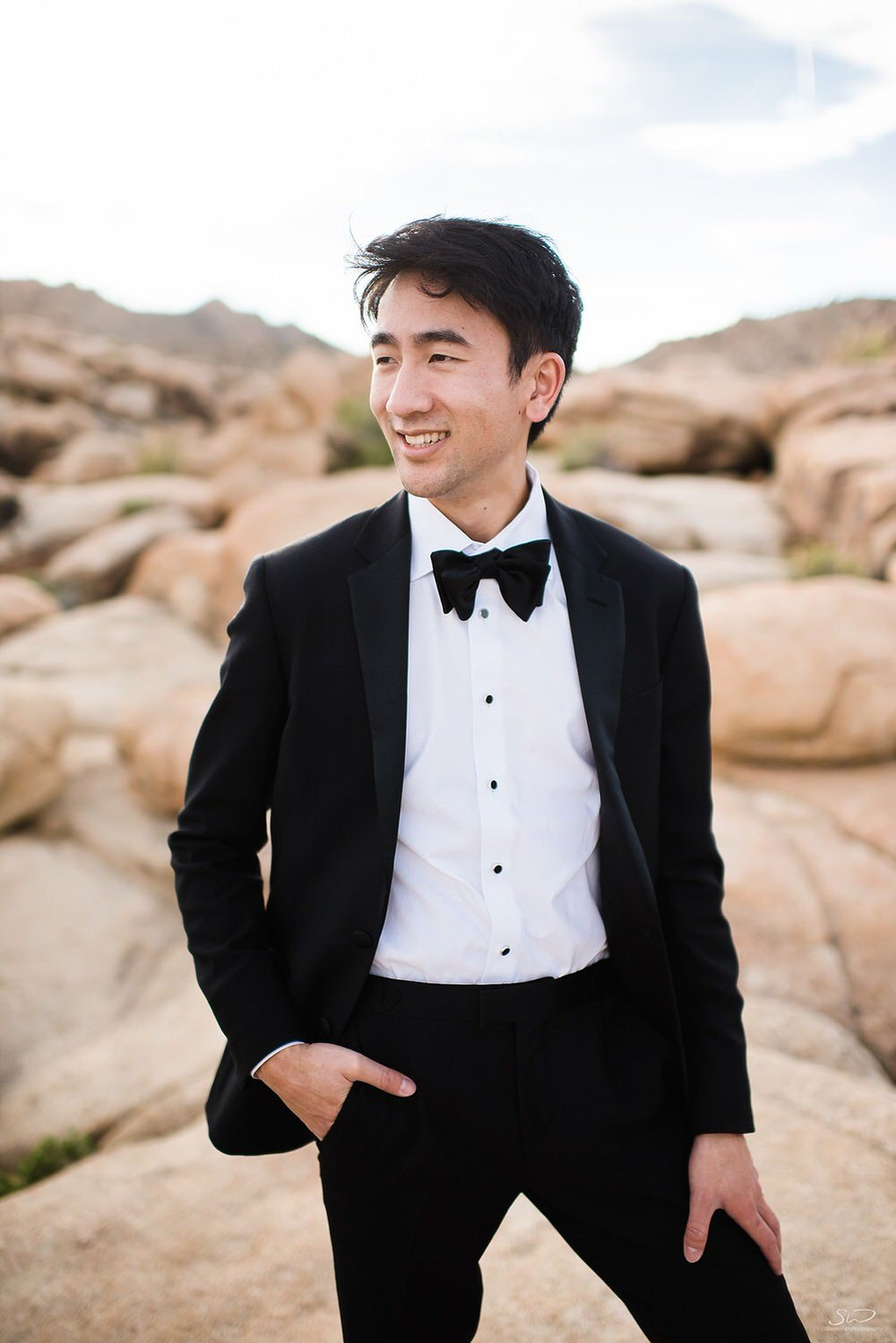 Groom with tux posing on rocks | Joshua Tree Desert Wedding, Engagement, Elopement Inspiration