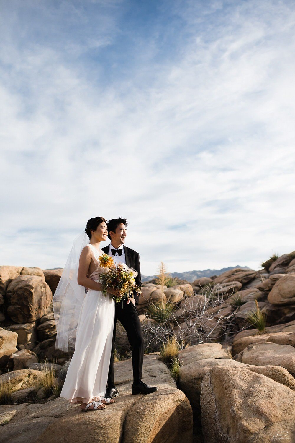 Couple portrait looking into the sun | Joshua Tree Desert Wedding, Engagement, Elopement, Adventure Inspiration