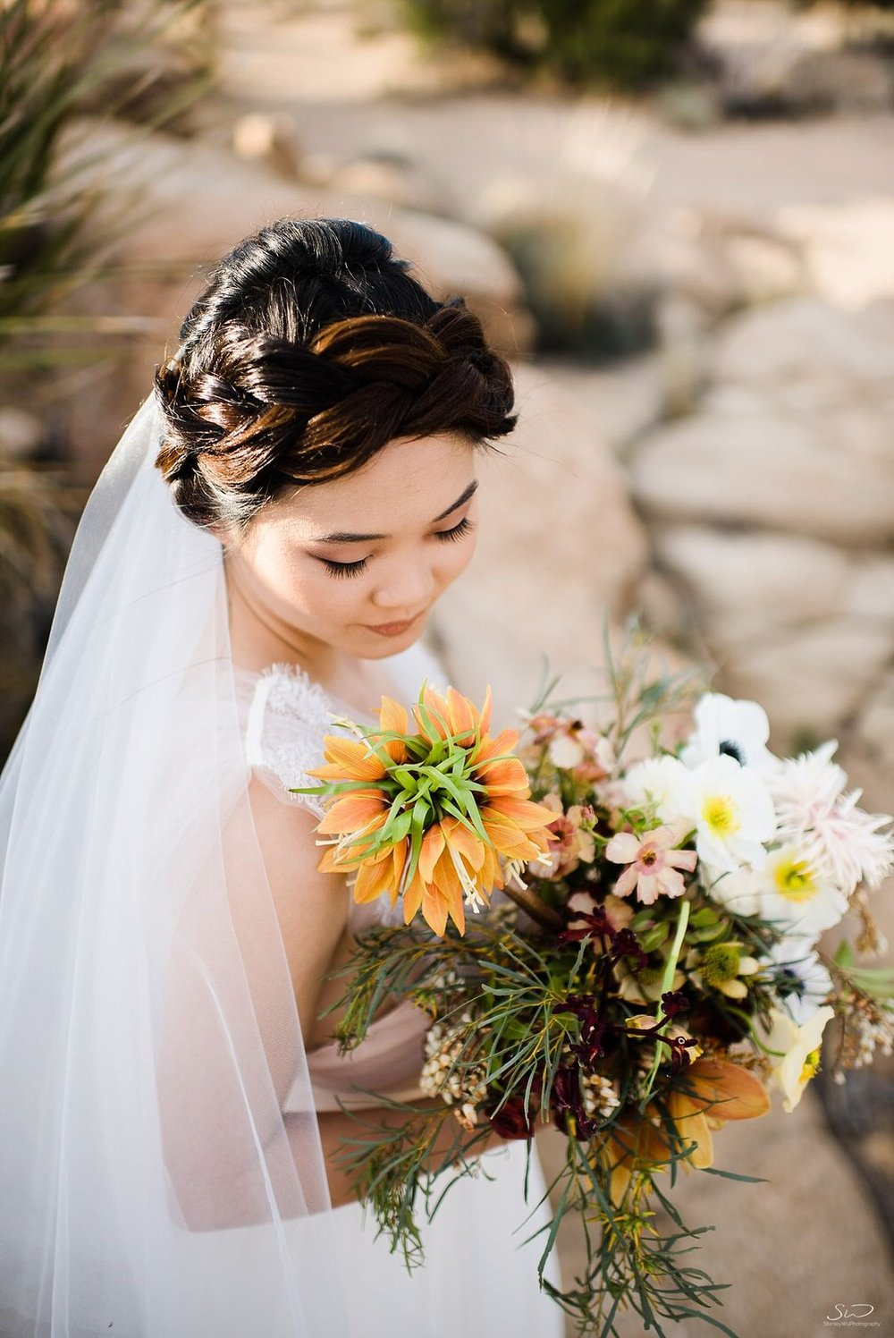 Beautiful bridal dress with wedding bouquet | Joshua Tree Desert Wedding, Engagement, Elopement Inspiration
