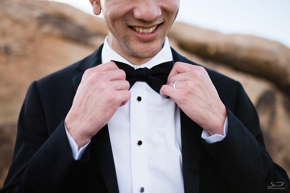 Groom fixing bowtie getting ready | Joshua Tree Desert Wedding, Engagement, Elopement Inspiration