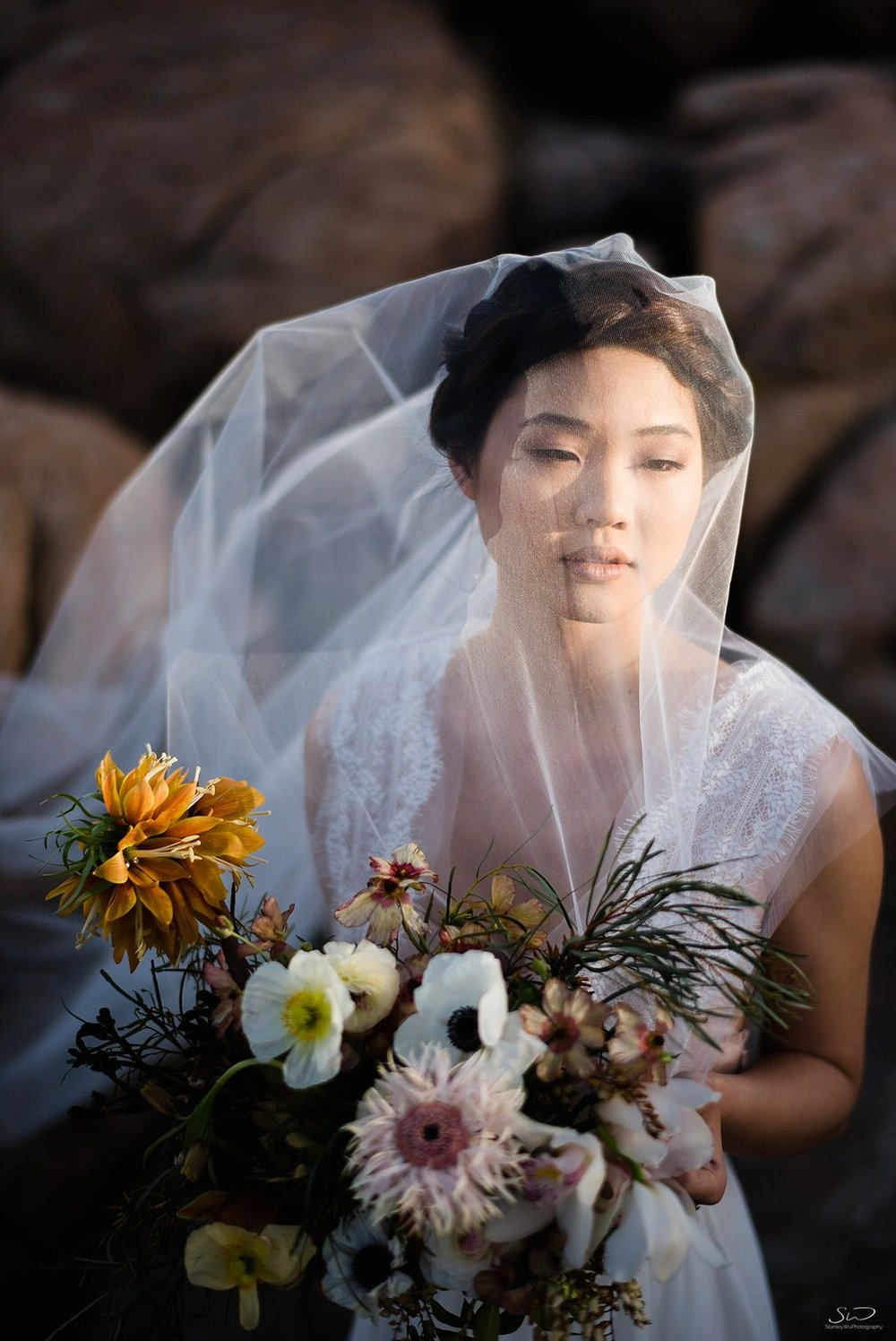 Dramatic bridal portrait with veil and bouquet | Joshua Tree Desert Wedding, Engagement, Elopement, Adventure Inspiration