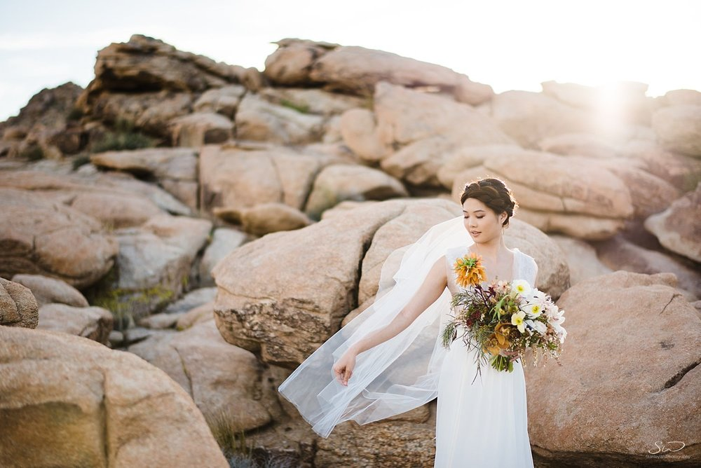 Bride playing with bridal veil and bouquet | Joshua Tree Desert Wedding, Engagement, Elopement, Adventure Inspiration