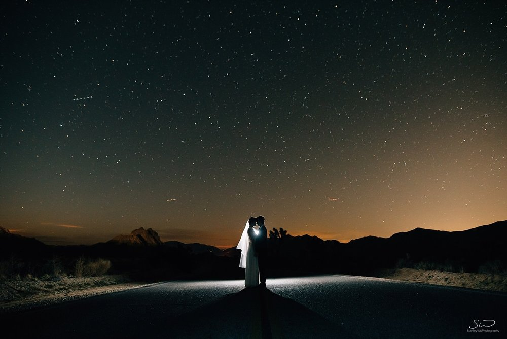Epic couple's portrait under the stars | Astrophotography | Joshua Tree Desert Wedding, Engagement, Elopement, Adventure Inspiration