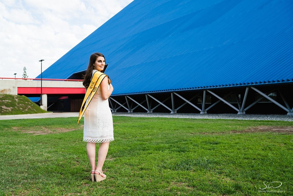 girl displaying sash graduation portraits at csulb pyramid