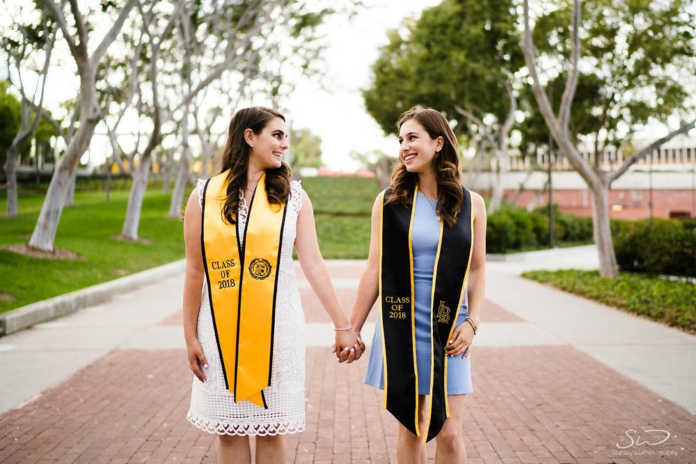 twin sisters hand in hand graduation senior photos portraits at csulb