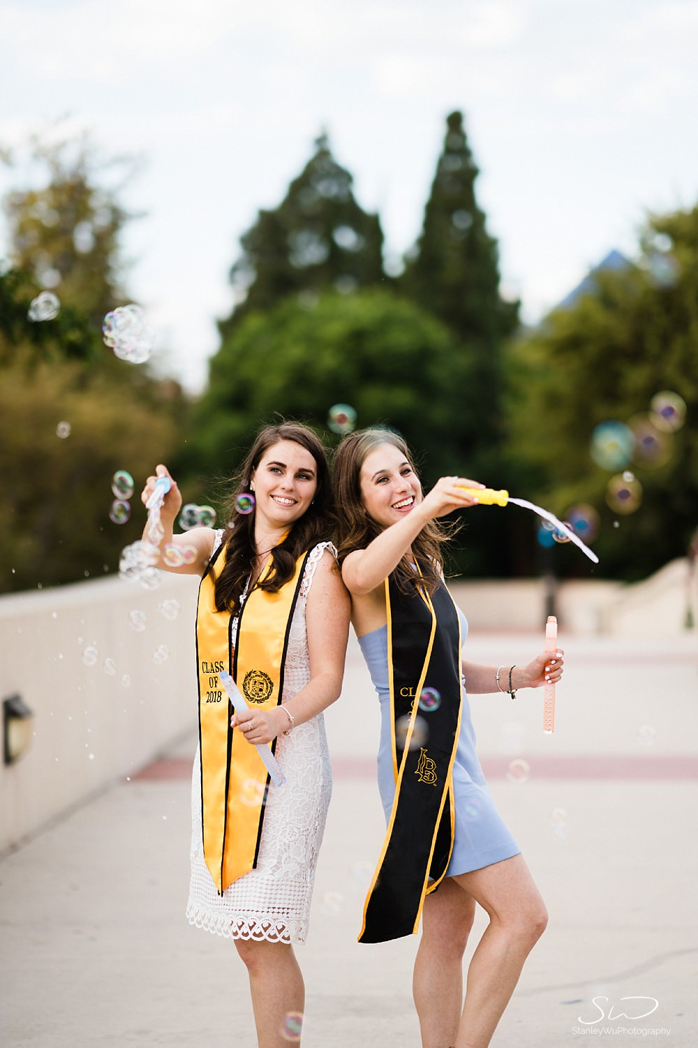 twin sisters blowing bubbles graduation senior photos portraits at csulb