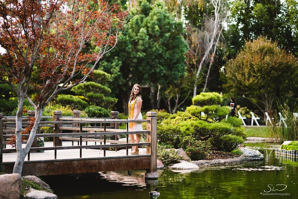 beautiful scene of a girl looking off  graduation portraits at csulb earl burns miller japanese garden