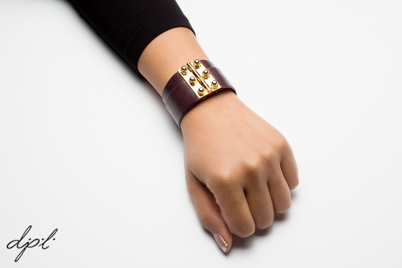 Double hinged cuff, plum leather.