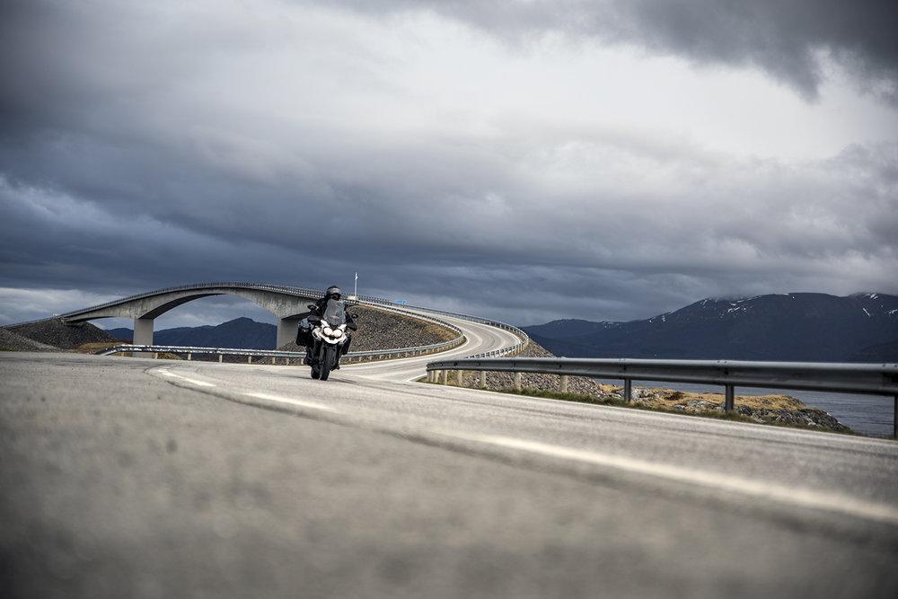 BIKE ON THE ROAD BY THE BRIDGE.jpg