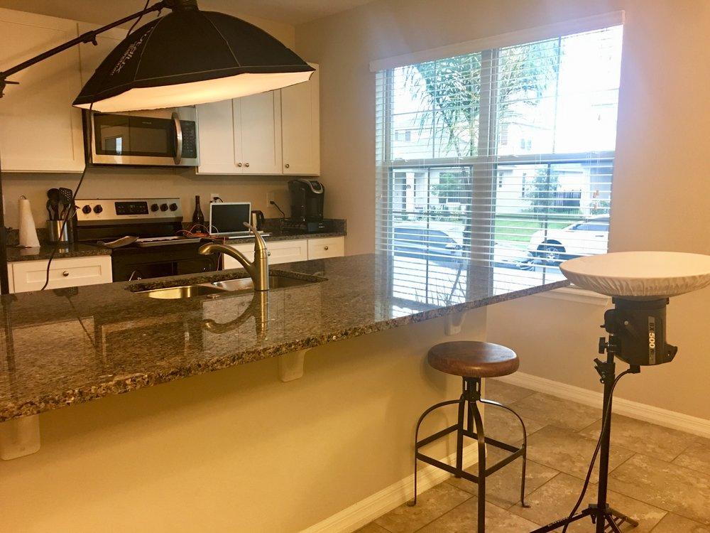 At-home photo shoot with lighting setup
