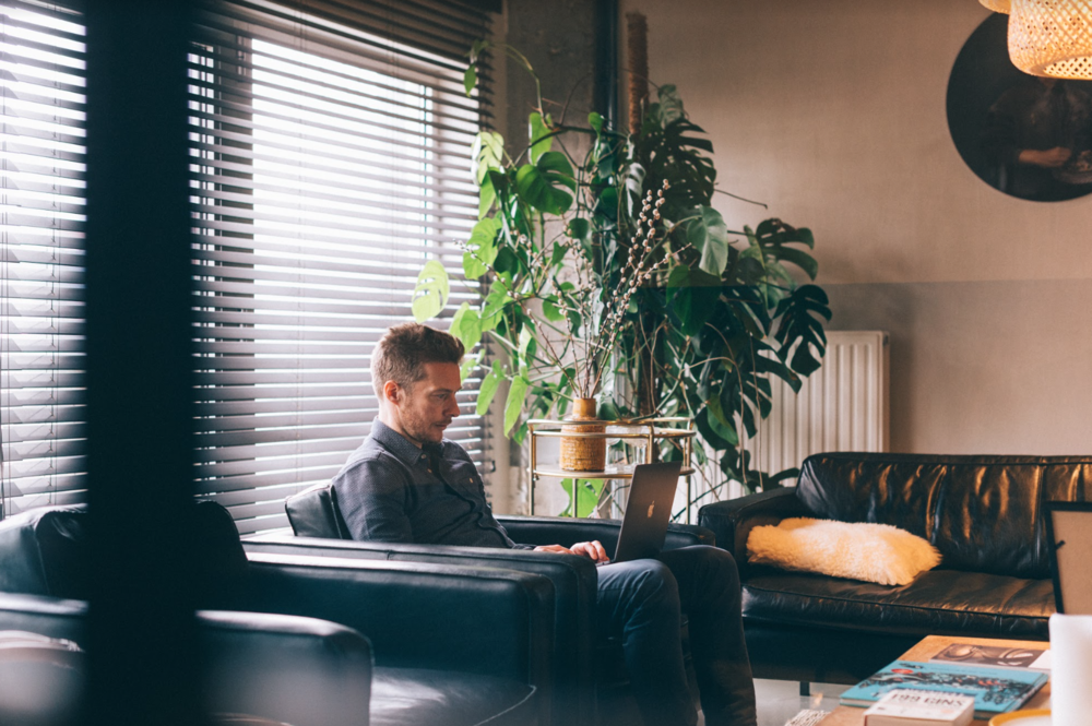 Bart Lizen at work in his favourite Fosbury & Sons Harmony nook. Photography by Jeroen Leurs