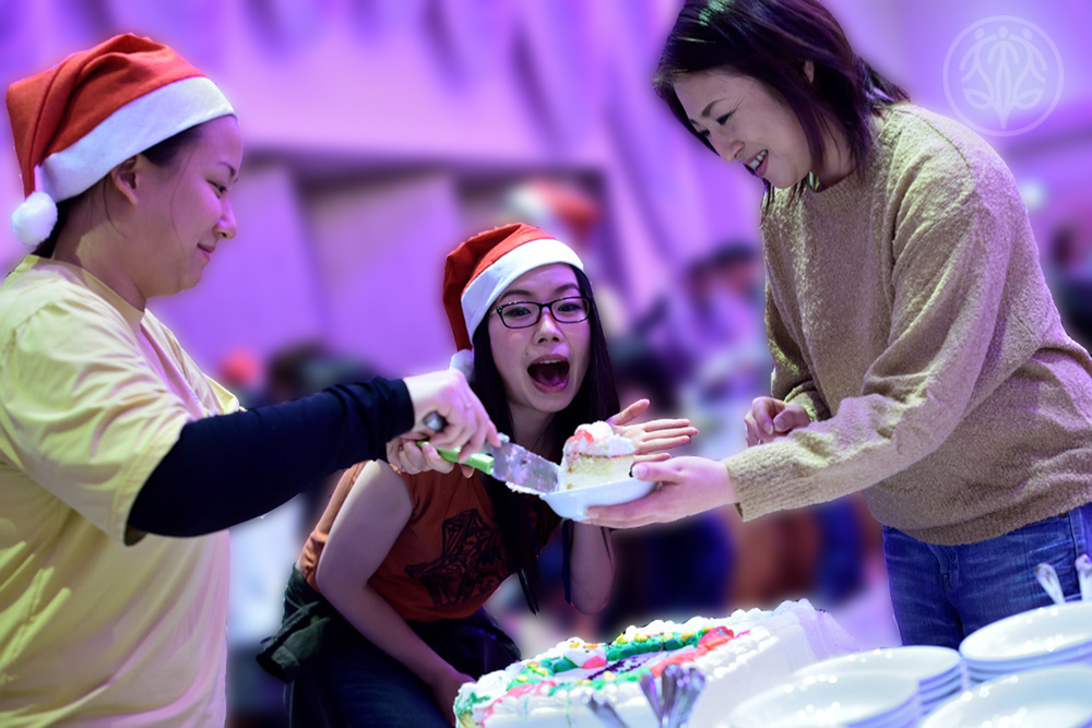 Volunteers have their cake and eat it too, at Santa Soul Train on December 11th, 2015.