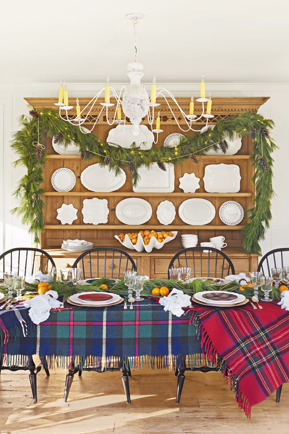 2) Use your scarves, blankets or kaftans as table cloths. - I am sure you have some plaid scarves laying around in your closet! Get them out and use them! In a brand new way! Put them on your table! Add some greenery, candles or fruit for a super awesome centerpiece to your celebration!