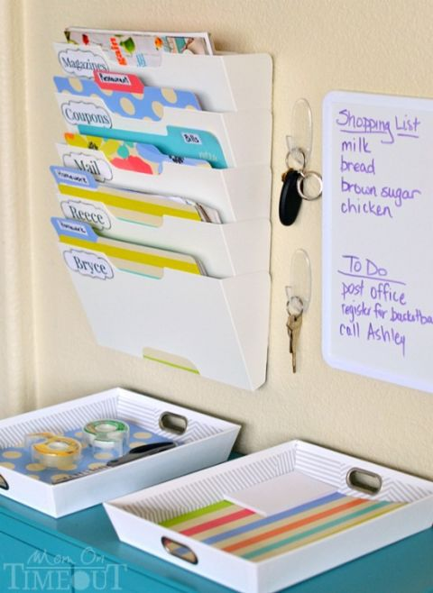 1-Make a command center - Make a command center- Have a folder for each kiddos paperwork, a white board for notes and messages, drawers with extra supplies, bins for backpacks or shoes and anything else you need to keep at your fingertips for grab and go! Our team has done many custom organization/mudroom solutions to help with these problems!