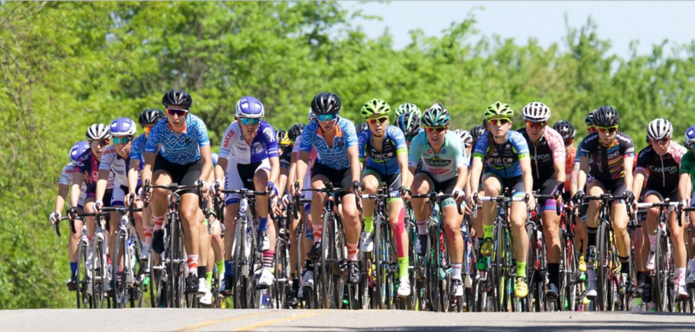 CWEC leads the peloton over a roller on Stage 3