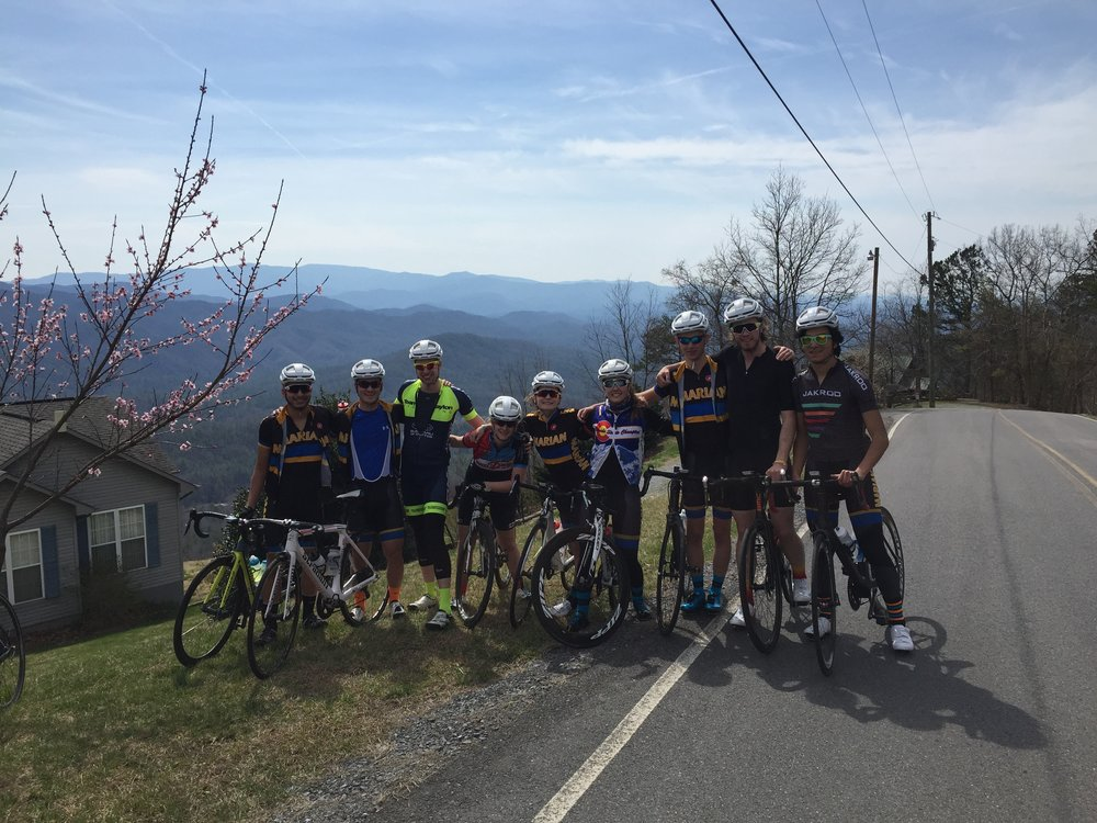 All smiles at the top of Happy Valley climb at the Top of the World on Day One.