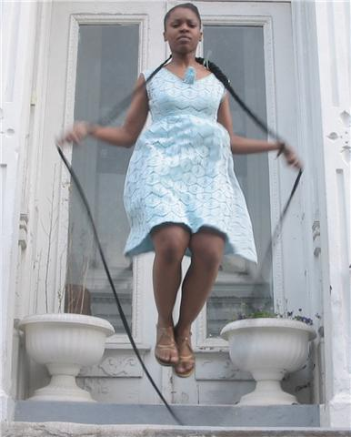Cousins jumps Diva Dutch on her stoop in BedStuy, an historically black neighborhood in Brooklyn, NY. Her 15 foot braid was created by local hairbraiding legend Amy Sakko. She later traveled to historically black neighborhoods in London (Brixton) and Paris (Barbès–Rochechouart) to perform the piece there. A photo of her performance in Paris appears in this   interview    with the Studio Museum in Harlem's Magazine