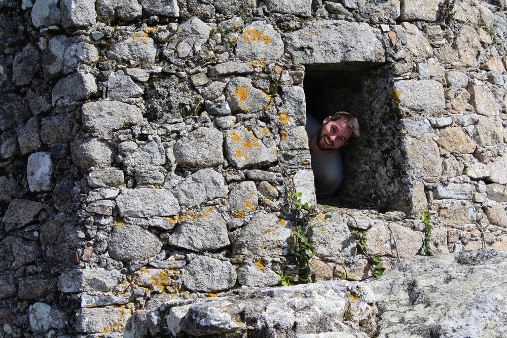 Photograph by Lauren Martin - Kyle peaking his head out the Castle walls.
