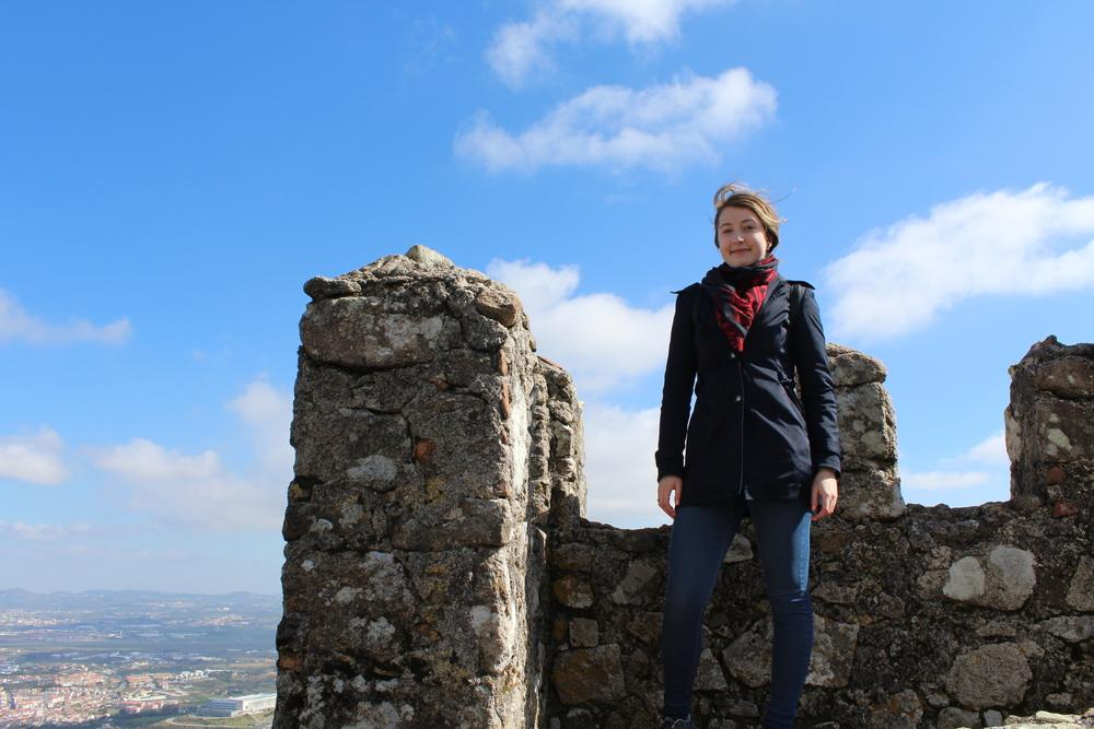 Lauren standing on top of the world.