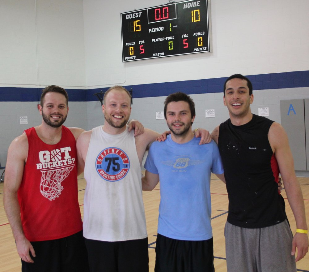 The SCP Second Annual 3-on-3 Basketball Tournament winning team included (from left) Alex Otec, Scott Clithero, Nathan Maul, and Eric Lewis. They took the final championship game with a 15-10 score against the second place team which was led by St. Louis College Prep Basketball Coach Torrey Davie.