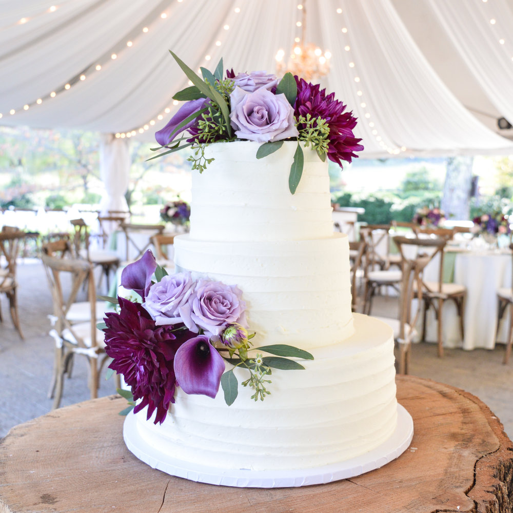 Buttercream wedding cake w purple flowers.jpg