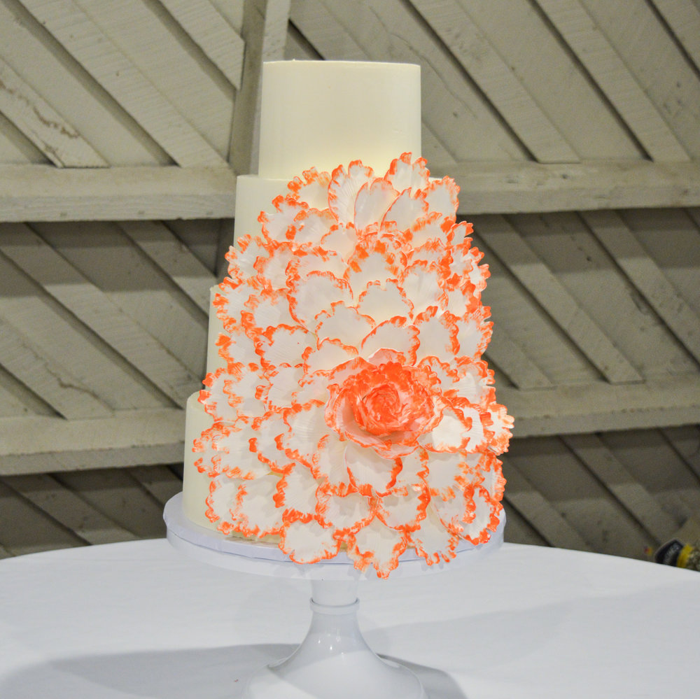 Orange flower wedding cake.jpg