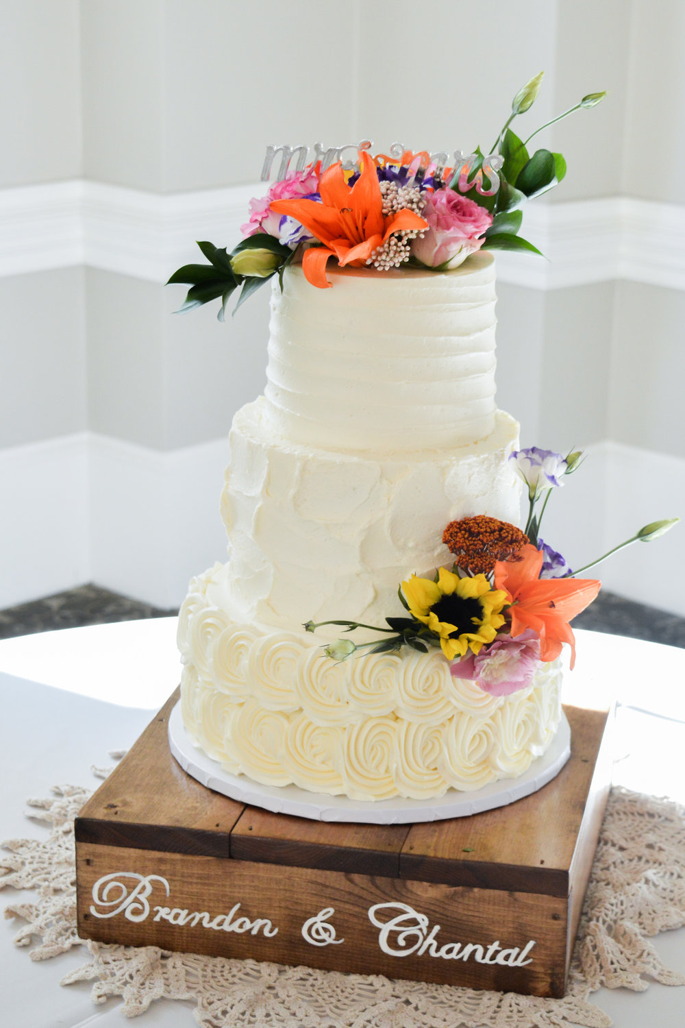Buttercream wedding cake fresh flowers.jpg