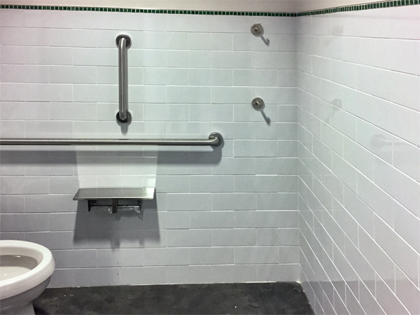 Coat hooks in toilet room or stall at accessible height and standard height  | Registered Accessibility