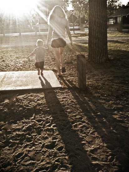 - My oldest son and I when I was still a single mother, walking back from the beach.