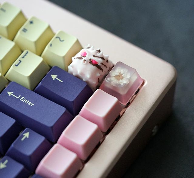 Rose gold M65 with GMK Plum. Cherry Blossom Fugu, Hanami Bento Blank and Clack Octopink. #mechanicalkeyboard #mechanicalkeyboards #artisankeycaps #geekhack