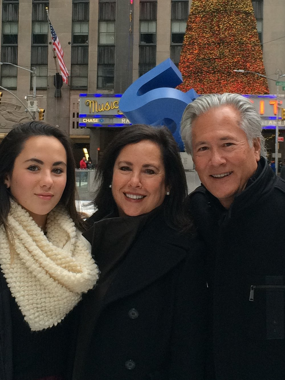 Photo of Melissa with daughter Ann Louise and husband Bob