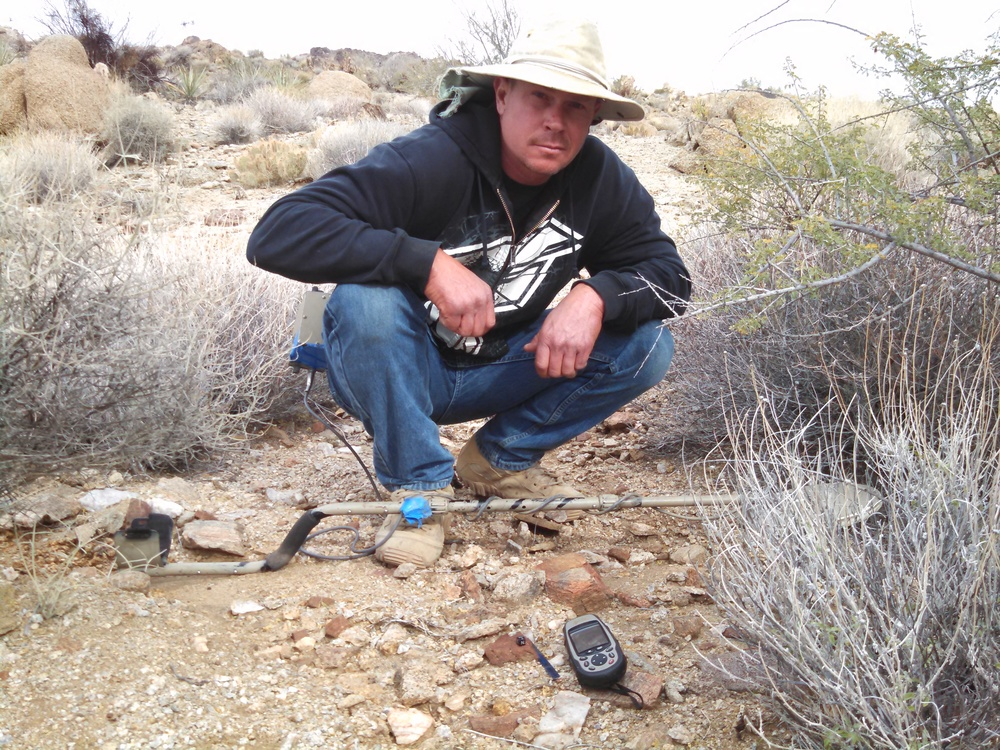 Joe with another of his many meteorite finds.  Photo Larry Atkins