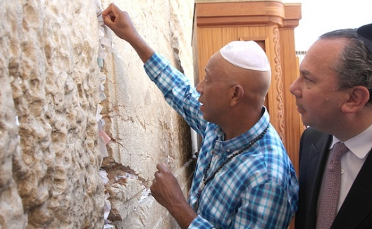 From left: Russell Simmons and Rabbi Marc Schneier visit the Western Wall during a 2012 trip to Israel. Photo by Sasson Tiram