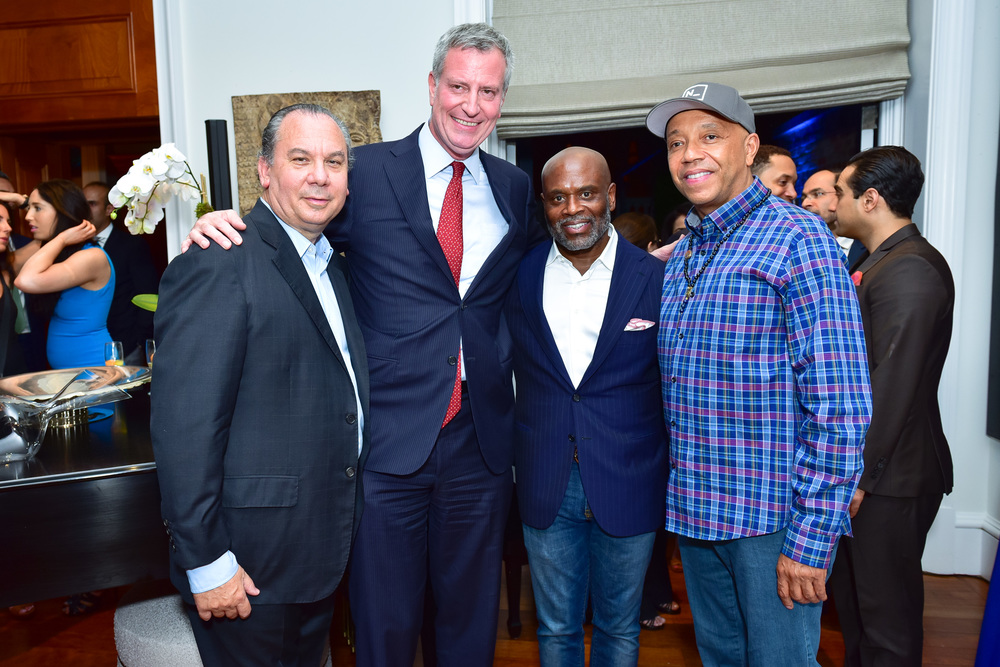 (L-R:) FFEU President Rabbi Marc Schneier, New York City Mayor Bill de Blasio, Epic Records Chairman Antonio L.A. Reid and FFEU Chairman Russell Simmons.