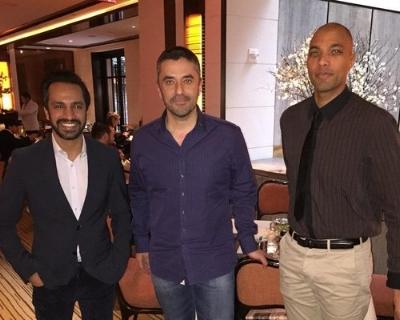 L-R: Amit Khera, H.E. Omar Saif Ghobash and Chris Sacarabany.