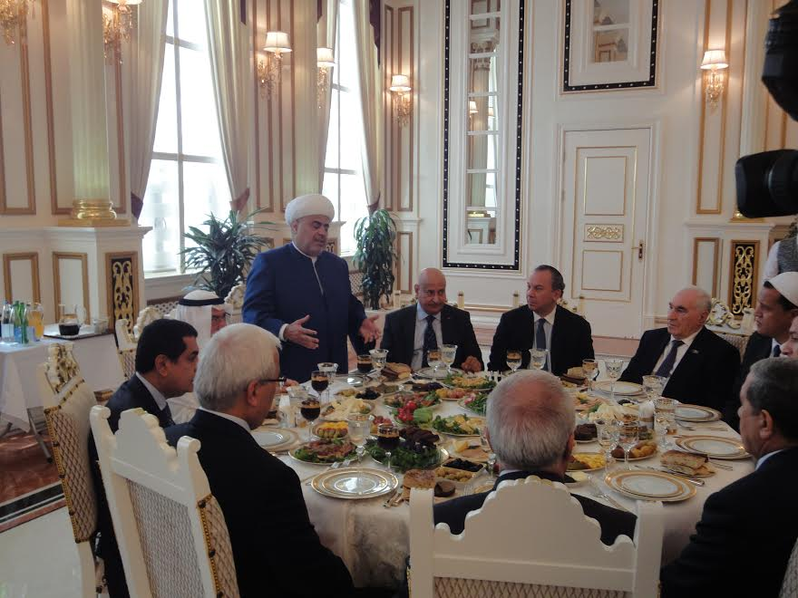 Chairman of the Caucasian Muslims Office Sheikh Allahshukur Pashazadeh (standing) presiding over guests in Baku, Azerbaijan, which includes FFEU President Rabbi Marc Schneier.