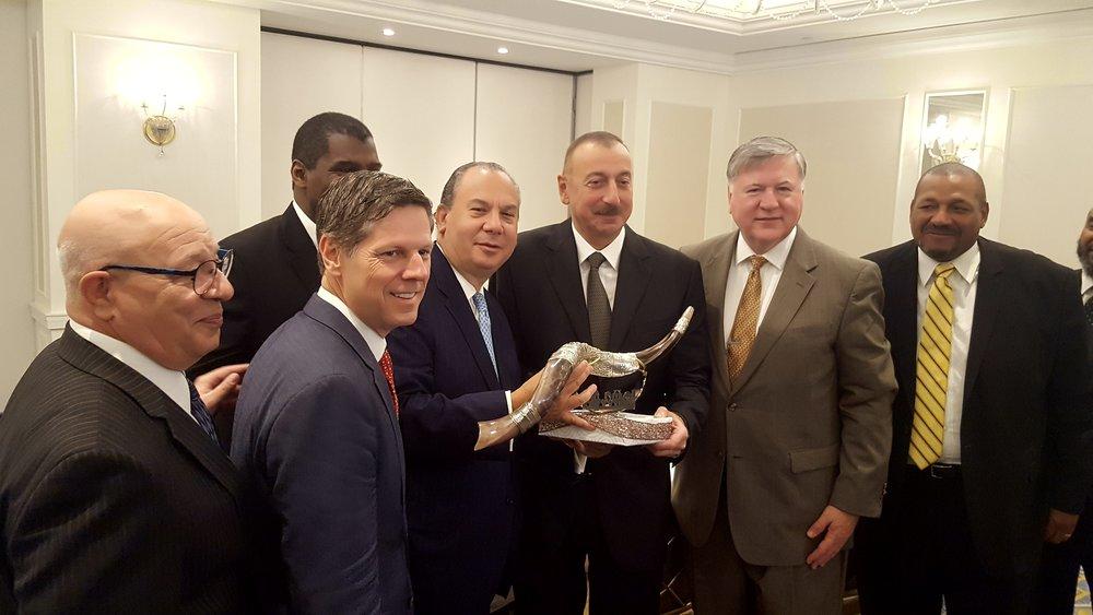 FFEU President Rabbi Marc Schneier presenting a shofar to President of Azerbaijan, His Excellency Ilham Aliyev (middle).