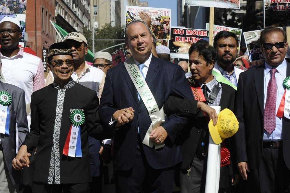 Rabbi Marc Schneier (center) revels in role Sunday as honorary grand marshal of the Muslim Day Parade he marches arm in arm with Imam Shamsi Ali (left). (Andrew Savulich/New York Daily News).
