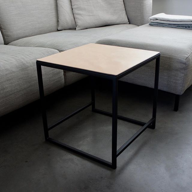 Our coffee table. Black powder coated steel with leather top. Completely made in Holland. Multiple leather available. Dimensions 40x40x40cm.