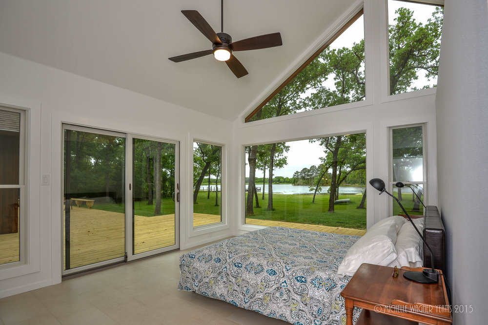 Remodeled bedroom, with plenty on windows to create a sense of place in Bryan / College Station, Texas.