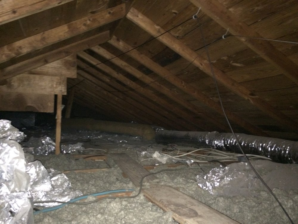 Sealed attic, part of a home remodel in Bryan / College Station by Stearns design build.