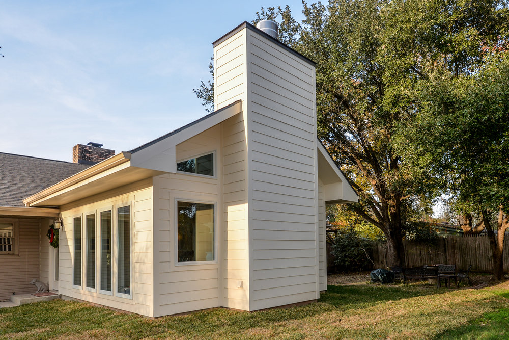 A home addition in Bryan / College Station, by Stearns design build. Windows help to deal with thermal masses.