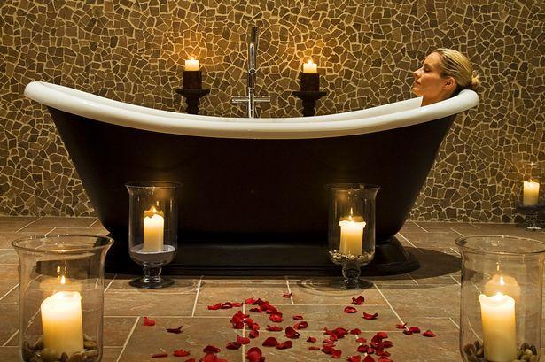 A-woman-enjoys-a-hot-soak-in-the-luxurious-slipper-bath.jpg