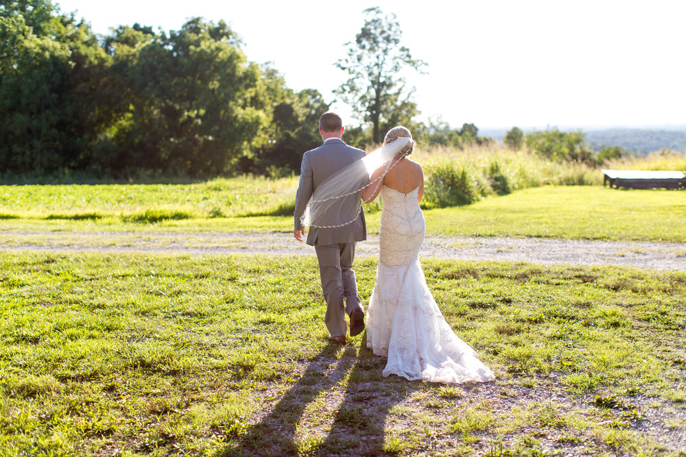 This couple is near and dear to my heart because the groom's older sister was one of my college roommates. Jarron Bolton and Jessica Parker were married on July 29th, 2017, at Burdoc Farms in Crofton, KY, which is about 3 hours away from Lexington. This was the Willard family's first road trip with Anna and she did so great (you can even see a few pictures of her towards the end). Jarron is a big ole country boy with the biggest, sweetest heart, and I'm sure as you look through these pictures you will be able to tell. This whole day felt like I was just hanging out with my family, which made it even more special! I hope you enjoy this colorful and joyful wedding.