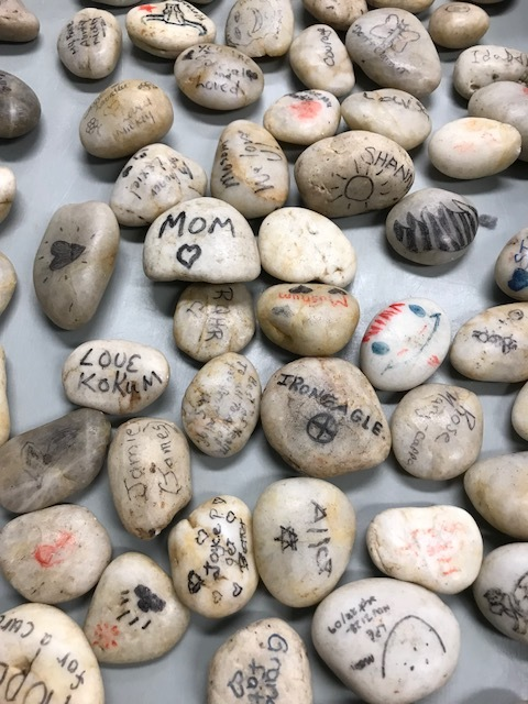 Rocks with Messages, Names, and Drawings Honouring Loved Ones Living with Dementia.