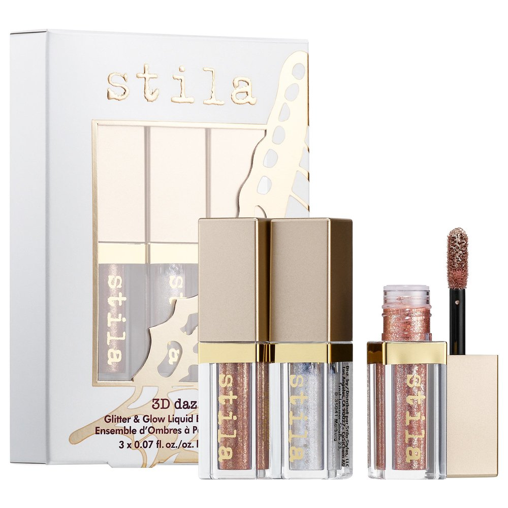 STILA   3D DAZZLE MINI GLITTER AND GLOW LIQUID SHADOW SET $25.00 I have a couple of these and I am obsessed with them! They really just take your eye look to the next level. I have gifted them to a bunch of friends and they all are obsessed with them now too. This and a eyeshadow palette would be such a fun gift. Or even this alone would be amazing too!   https://www.sephora.com/product/3d-dazzle-glitter-glow-liquid-shadow-set-P435968?icid2=products%20grid:p435968:product