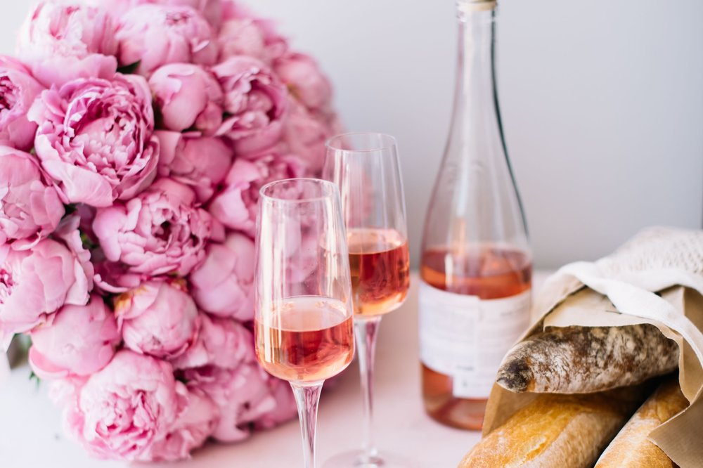 stock-photo-delicious-refreshing-bottle-of-rose-wine-with-two-glasses-huge-pink-blossoming-peony-flowers-1123292981.jpg