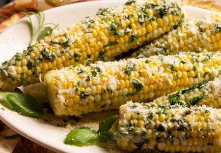 corn on the cob with herb butter.png
