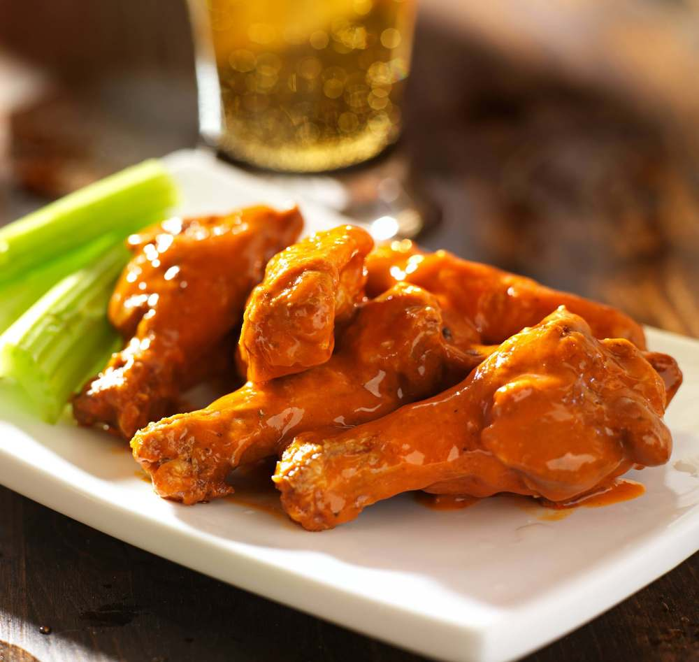 Wings and beer on bar