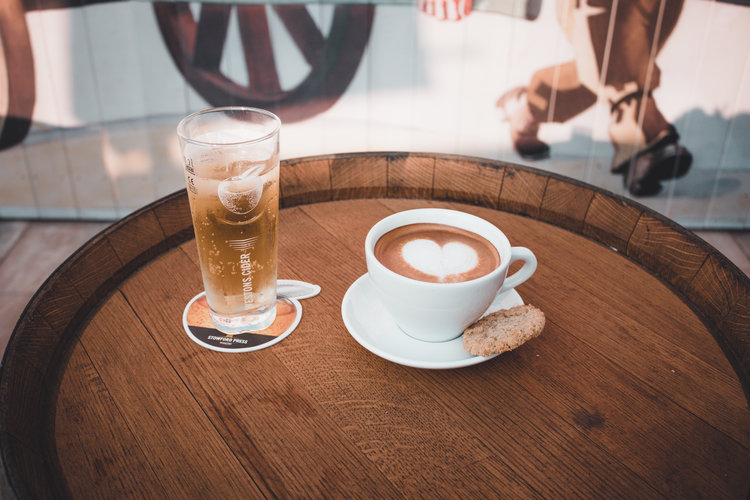 wooden table with cider and coffee on display